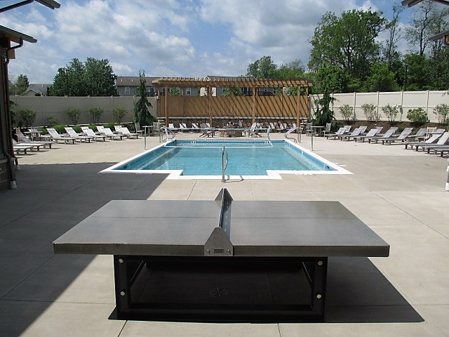 Concrete Ping Pong Table With Steel Base Shown In The Heights At State College Pool Area