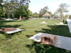 Concrete cornhole boards shown at a park in Winnetka, IL
